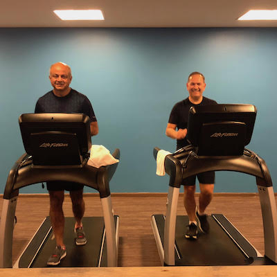 IMAGE: SVN's Derek Lobo, left, works out with John Faratro of SVN Montreal at a convention in New Mexico. (Image courtesy SVN Rock Advisors Ltd.)