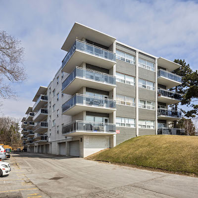 IMAGE: This apartment building at 74 Curlew Dr., in Toronto is among 13 assets being sold by Akelius. (Courtesy JLL)