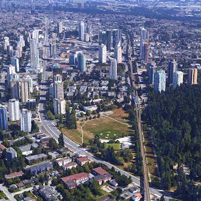 IMAGE: Aerial view of the Burnaby Metrotown area of Metro Vancouver, with Translink's Expo line rail transit line bisecting the view. (Google Maps image)