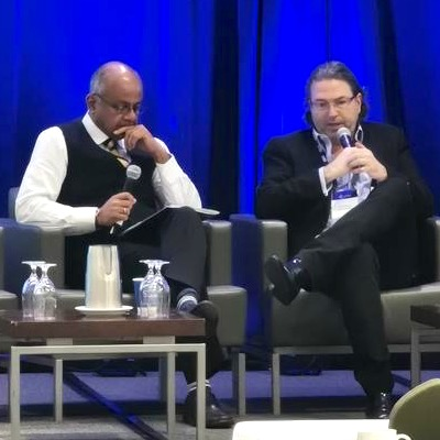 IMAGE: Alan Greenberg (right), formerly of Minto Group, is interviewed by Derek Lobo at the AptCon 2019 conference in Toronto. (Courtesy SVN Rock Advisors)