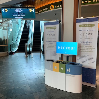"""IMAGE: """"Oscar"""" employs AI and computer vision to assist people at Vancouver International Airport in properly disposing (and recycling) their waste. (Courtesy Vancouver Airport Authority)"""