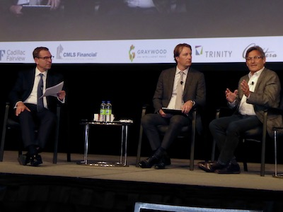 IMAGE: From left, CBRE Canadian Capital Markets president Peter Senst, and First Capital president and CEO Adam Paul interview First Capital founder Dori Segal during the Land & Development conference in Toronto. (Steve McLean RENX)