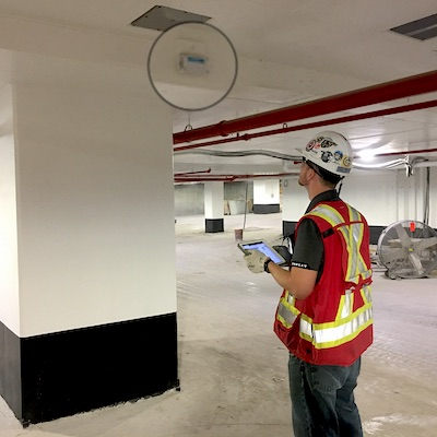 IMAGE: PCL Construction is using smart building technologies (sensor shown enlarged, in black circle, for visibility) which provide real-time data and analytics on its major construction projects. Downtown Toronto's 16 York St. is among them. (Courtesy PCL)