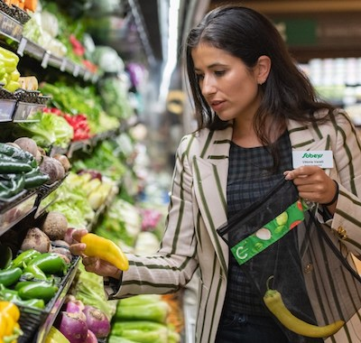 IMAGE: Vittoria Viralli, the vice president of sustainability for Sobeys, uses a reusable mesh bag which will be provided for produce at Sobeys stores. (Courtesy Sobeys Inc.)