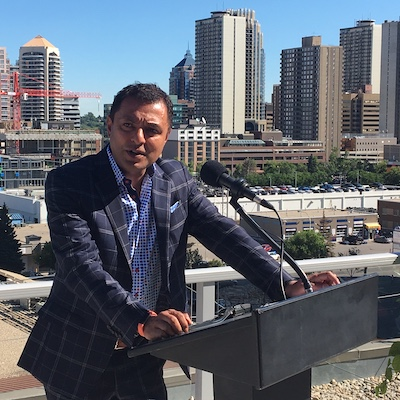 IMAGE: Strategic Group CEO Riaz Mamdani speaks during the official unveiling of the office-to-apartments conversion of the Cube in downtown Calgary. in July, 2019. (Mario Toneguzzi RENX)