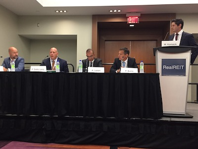 """IMAGE: Participants in a panel discussing """"niche"""" REITs at RealREIT in Toronto, from left: Milton Lamb of Automotive Prperties REIT, Paul Dalla Lana of Northwest Healthcare Properties REIT, AHIP REIT's Azim Lalani, and ERES REIT's Phillip Burns, with moderator Matt Kornack of National Bank Financial. (Steve McLEAN RENX)"""