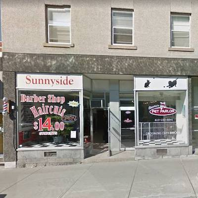 IMAGE: This barbershop is the only retail location which hasn't changed uses along a stretch of Ottawa's Bank St. during the past half century.