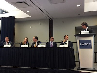 IMAGE: Apartment panelists at the RealREIT conference in Toronto Sept. 5, 2019 were, left to right: Dean Wilkinson of CIBC Capital Markets, Lisa Russell of Boardwalk REIT, Jonathan Fleischer of CAPREIT, Brad Cutsey of InterRent REIT, Todd Cook of Northview Apartment REIT, and moderator David Bloomstone of TD Securities. (Steve McLean RENX)
