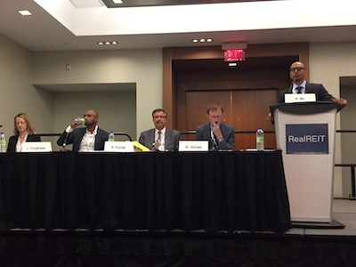 IMAGE: Panelists discussing REIT diversification at the RealREIT conference in Toronto were, from left: Kim Riley of Artis REIT, Joshua Varghese of CI Investments, Peter Forde of SmartCentres REIT, Glenn Hynes of Crombie REIT, and moderator Pammi Bir of RBC Capital Markets. (Steve McLean RENX)