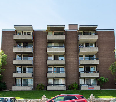 IMAGE: The ExecSuite Forest Hill apartments building. (Courtesy Colliers International)