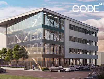 IMAGE: Code 440 is a combined office and industrial building, with exposed wood highlights, under construction in Laval. (Courtesy Cosoltec)