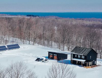 IMAGE: This Passive Design Solutions home was built north of Owen Sound, Ont. The residence is off-grid, and near net zero with a plan to add more solar panels. The owners use a small amount of propane for cooking and heat. (Courtesy David Stewart Media)