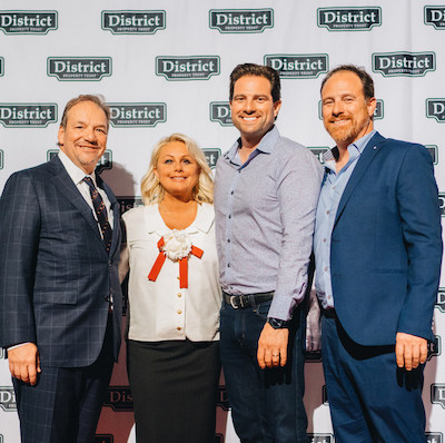IMAGE: Principals and trustees, from left, Richard Hall and Carmen Campagnaro, together with new District Property Trust partners, Scott and Andrew McGillivray. (Courtesy District REIT)
