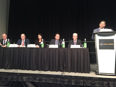 IMAGE: Apartment panelists at the Real Estate Forum 2019 in Toronto, from left: John Ballantyne of RioCan, Philip Fraser of Killam, Paula Gasparro of CMLS Capital, Alf Hendry of Homestead, and Mark Kenney of CAPREIT, with moderator Aik Aliferis of M&M. (Steve McLean RENX)