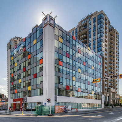 IMAGE: The Cube, an office-to-residential conversion in Calgary by Strategic Group. Despite much talk about office conversions, only five have actually been completed as the city's office market continues to struggle. (Courtesy Strategic Group)