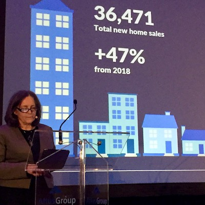 IMAGE: Patricia Arsenault, executive vice-president of research consulting for Altus Group Data Solutions, opens Altus' 12th annual Toronto State of the Market event. (Steve McLean RENX)