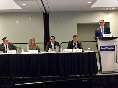 IMAGE: Panelists discussing real estate investing in uncertain economic times at the RealCapital Conference in Toronto, from left: William Secnik of Fiera Real Estate Investments; Jaime McKenna of Fengate Asset Management; Randy Hoffman of Oxford Properties Group; Ugo Bizzarri of Timbercreek; and moderator Peter Senst of CBRE. (Steve McLean RENX)