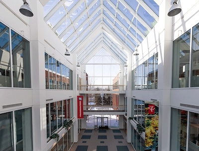 IMAGE: A section of the large, brightly lit atrium at 400 Sainte-Croix. (Courtesy Groupe Mach)