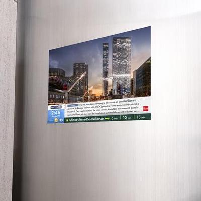 IMAGE: Pattison Outdoor Advertising and Devimco Immobilier have partnered to include Pattison's Digital Residential Elevator Network in 20 Montreal residential high-rise buildings and two office developments. (Courtesy Pattison Outdoor)