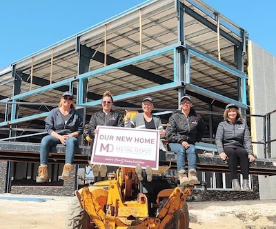 IMAGE: Staff members of Metal Depot check on the progress at their new home in the Plessis Business Park in Winnipeg. (Courtesy Metal Depot)