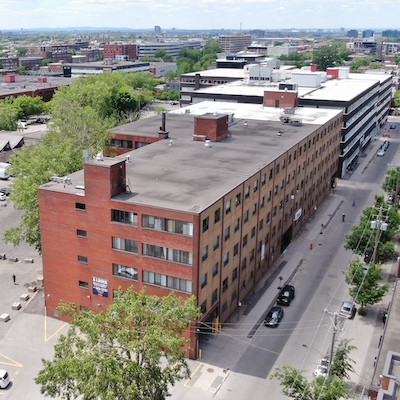 IMAGE: The 6600 Saint-Urbain office building in Montreal, which ha been acquired by Canderel. (Courtesy Canderel)