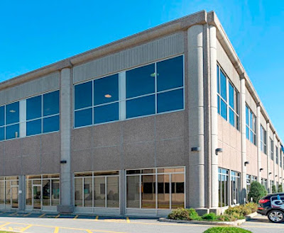 IMAGE: Groupe Quint has acquired this multi-tenant industrial building at 9175 Langelier Blvd. in the Montreal borough of Saint-Léonard as part of a two-property portfolio. (Courtesy Groupe Quint)
