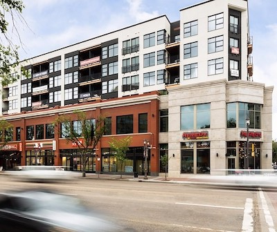IMAGE: The Raymond Block in Edmonton is a mixed-use apartment and office/retail complex. It is one of two new construction apartment buildings for sale in Edmonton. (Courtesy IPA)