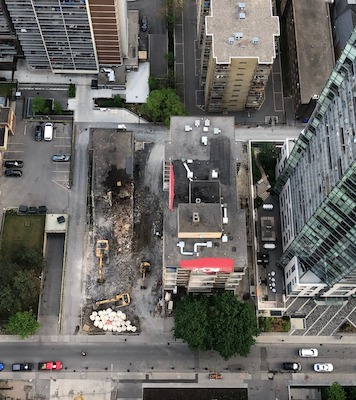 IMAGE: This aerial view shows the demolition site at 55 Charles St. E., where MOD is building the 55C condos. (Courtesy MOD)