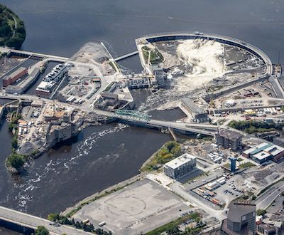 IMAGE: An aerial image of construction progress at the Zibi development on the Ottawa River, straddling the cities of Ottawa and Gatineau. (Courtesy Zibi)