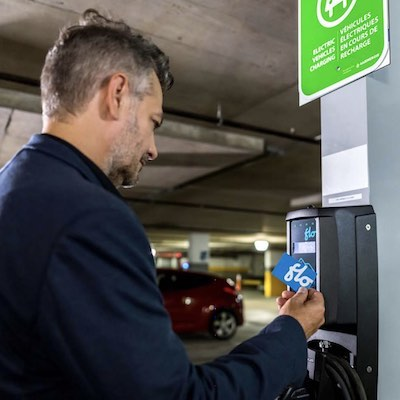 IMAGE: Electric vehicle charging stations from FLO (shown) and Tesla have been installed at many Cadillac Fairview properties across Canada. (Courtesy BOMA / FLO)