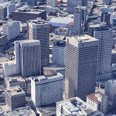 IMAGE: Portage and Main in downtown Winnipeg is now getting serious competition for its office tenants from the SHED District, just a few blocks away and anchored by the Bell MTS Place arena. The arena can be seen in behind, and between, the tall office towers in the foreground. (Google Maps)