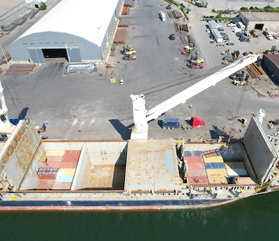 IMAGE: Loading the M/V Sedna Desgagnés, which has embarked on its first marine shipment of containers from Hamilton to the Port of Montreal. (Courtesy Hamilton-Oshawa Port Authority)