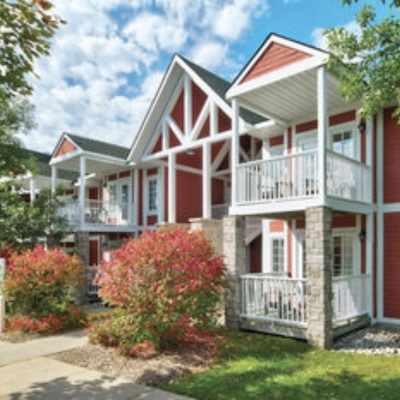 IMAGE: Sunray Group has acquired Carriage Hills Resort (shown) and Carriage Ridge Resort through a receivership transaction. It plans to convert the properties from timeshares to condos. (Courtesy Sunray/Colliers)